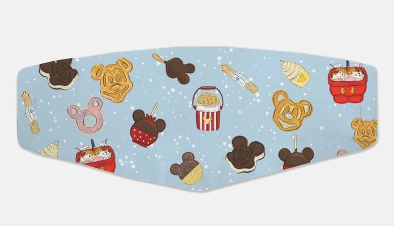 A blue face mask with Disney dessert cartoons on it