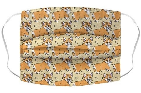 A mask with cartoon corgis showing off their lil butts