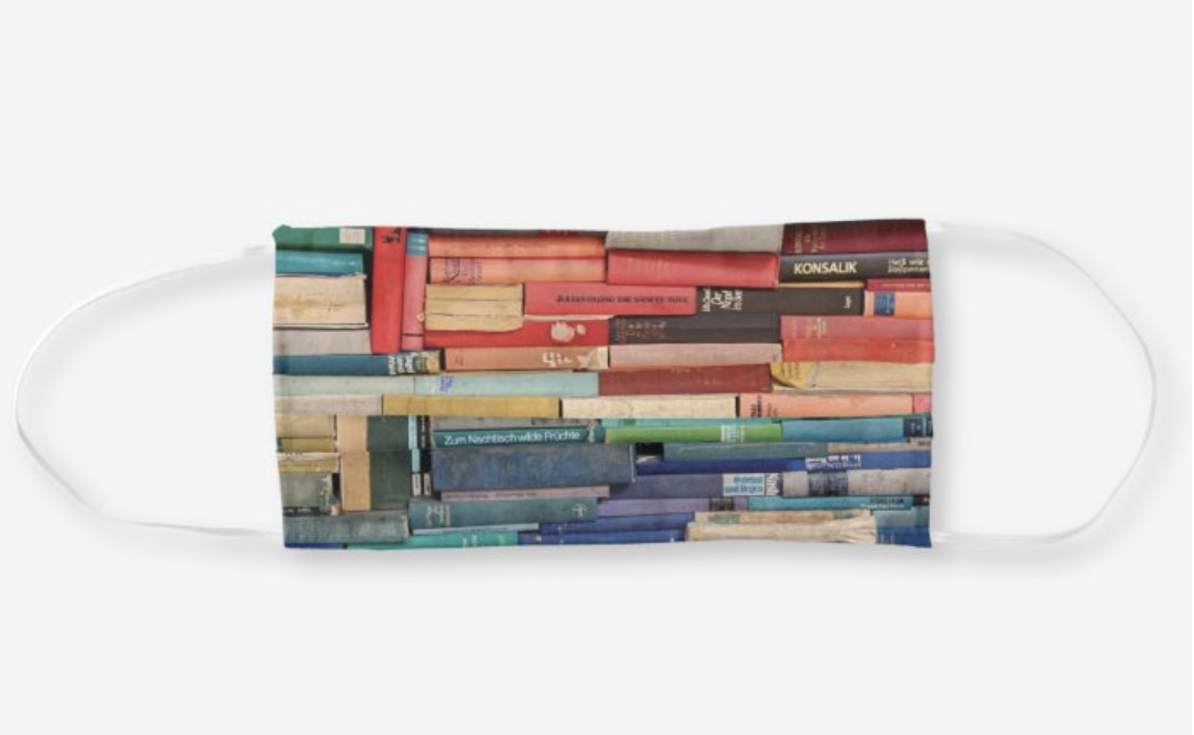 A face mask with watercolor books in different colors