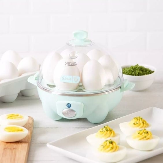 light blue Dash Rapid Egg Cooker next to plate with deviled eggs