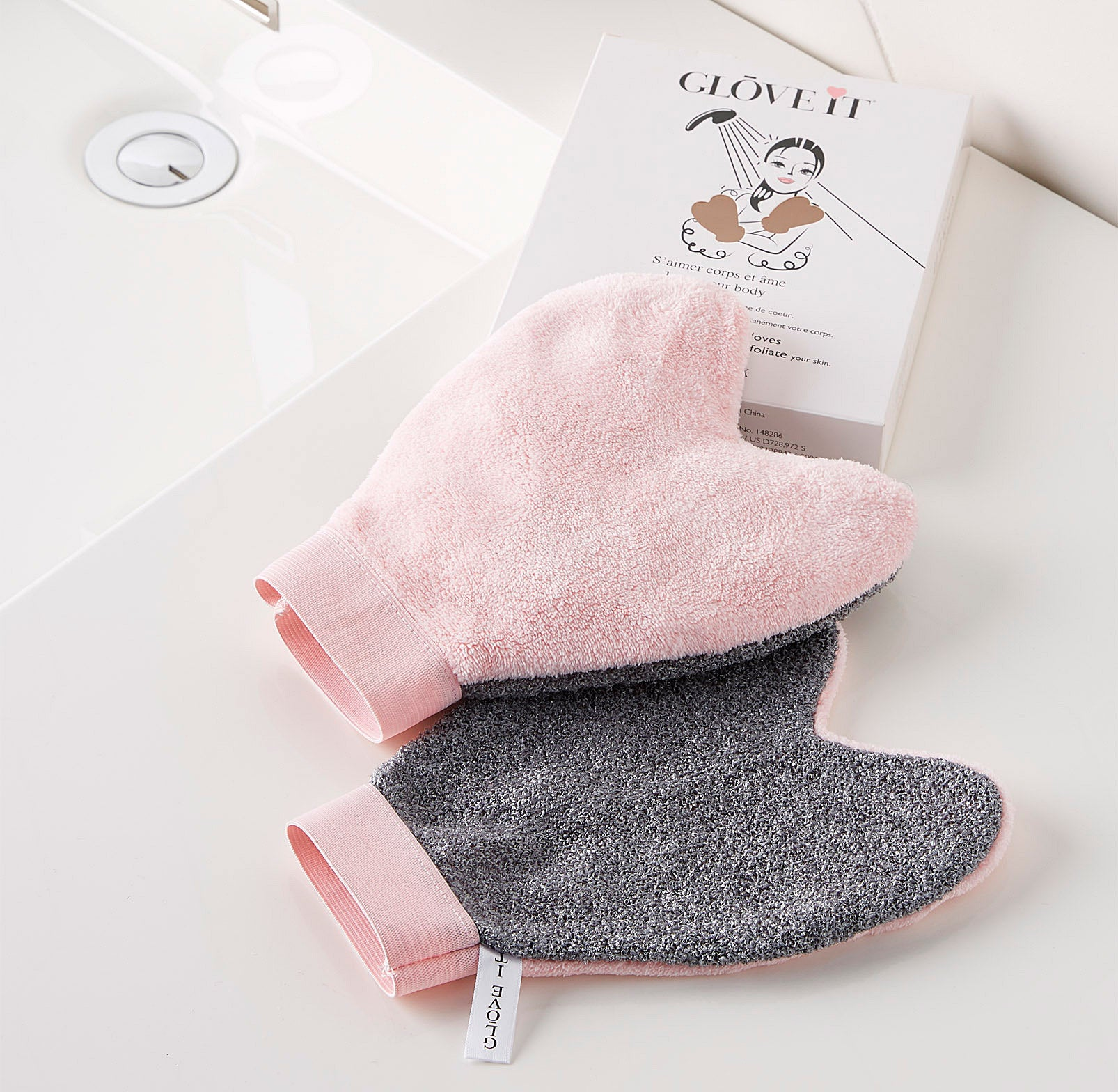 A pair of soft cloth wash gloves on a bathroom counter