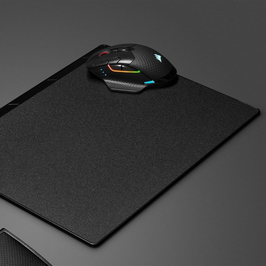 the black mouse with some rainbow detailers and buttons along the sides
