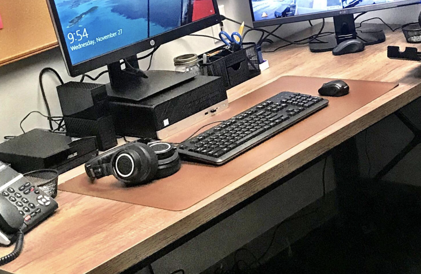 reviewer's desk pad on their desk with their keyboard and mouse on it