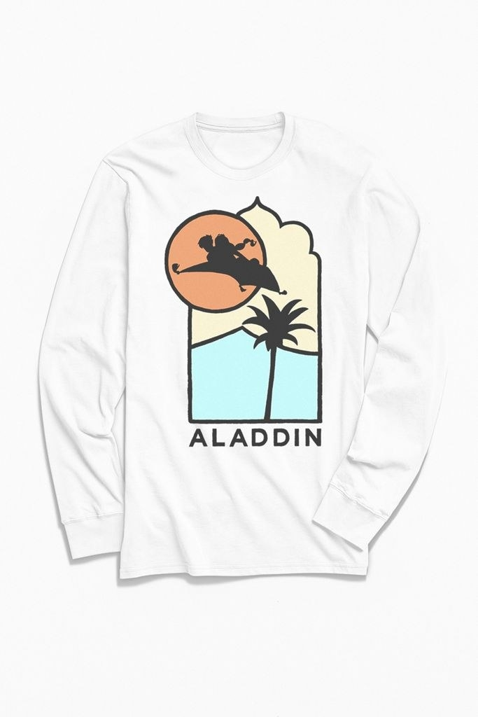 a white long sleeve with a graphic of aladdin and jasmine on the flying carpet