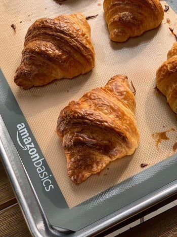 A reviewer's croissants cooked on a sheet pan