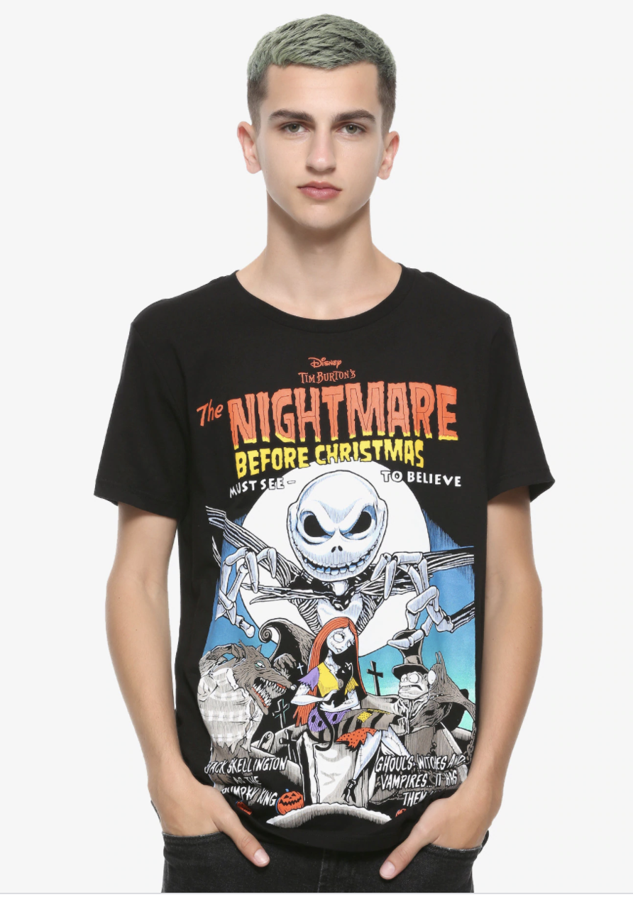 a model wearing a black tee with a vintage poster for the nightmare before christmas on it