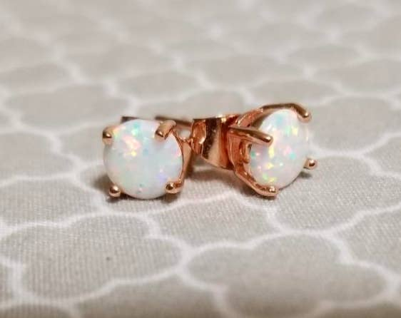 the rose gold and opal studs