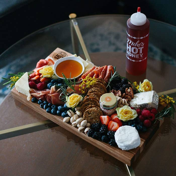 Dish of hot honey on a cheeseboard for drizzling and dipping