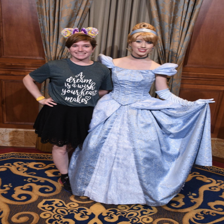 a reviewer wearing the shirt next to cinderella