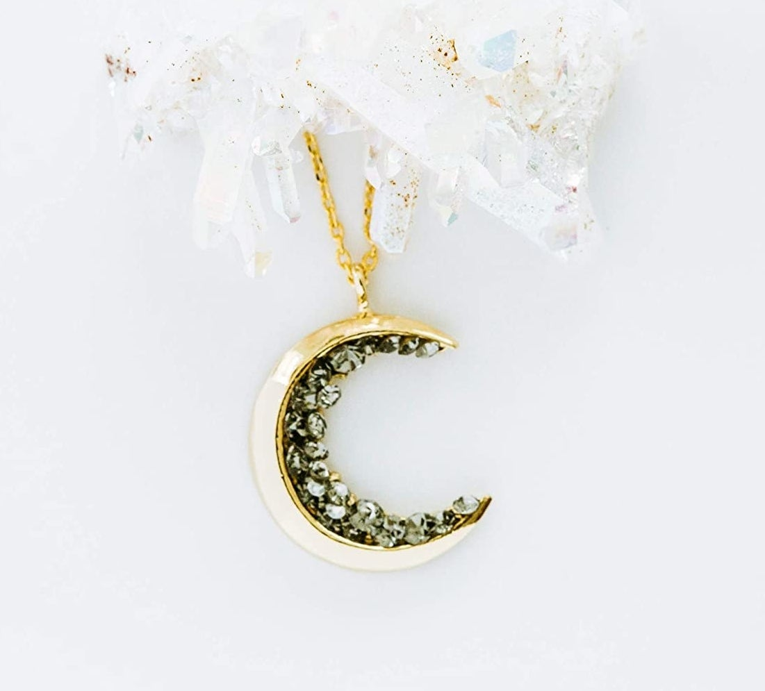 gold crescent pendant necklace with rhinestone details