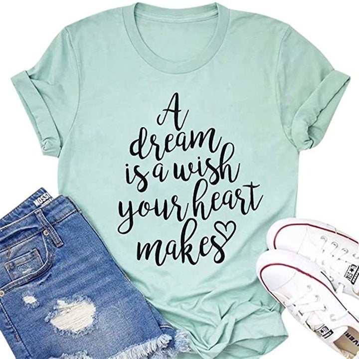 "a light blue tee with the words ""a dream is a wish your heart makes"" on it"