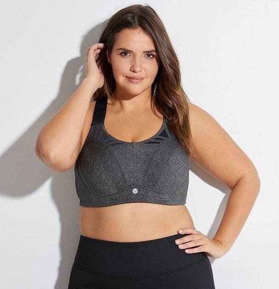 model wearing grey sports bra
