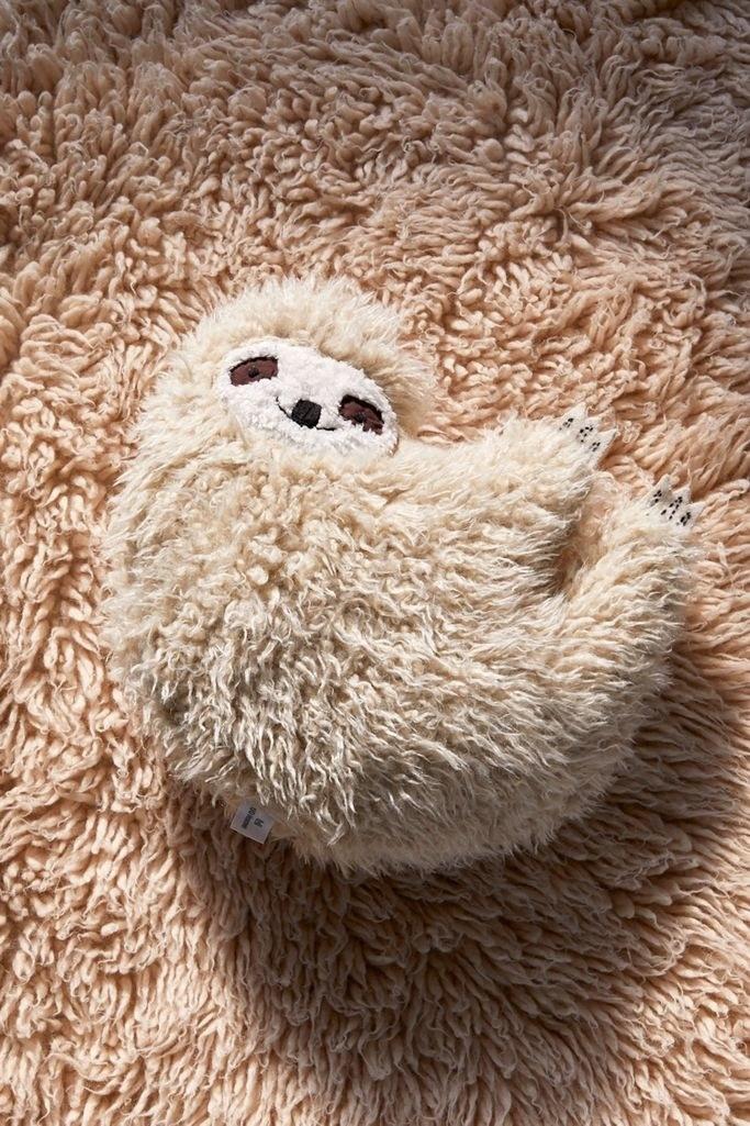 furry sloth-like throw pillow