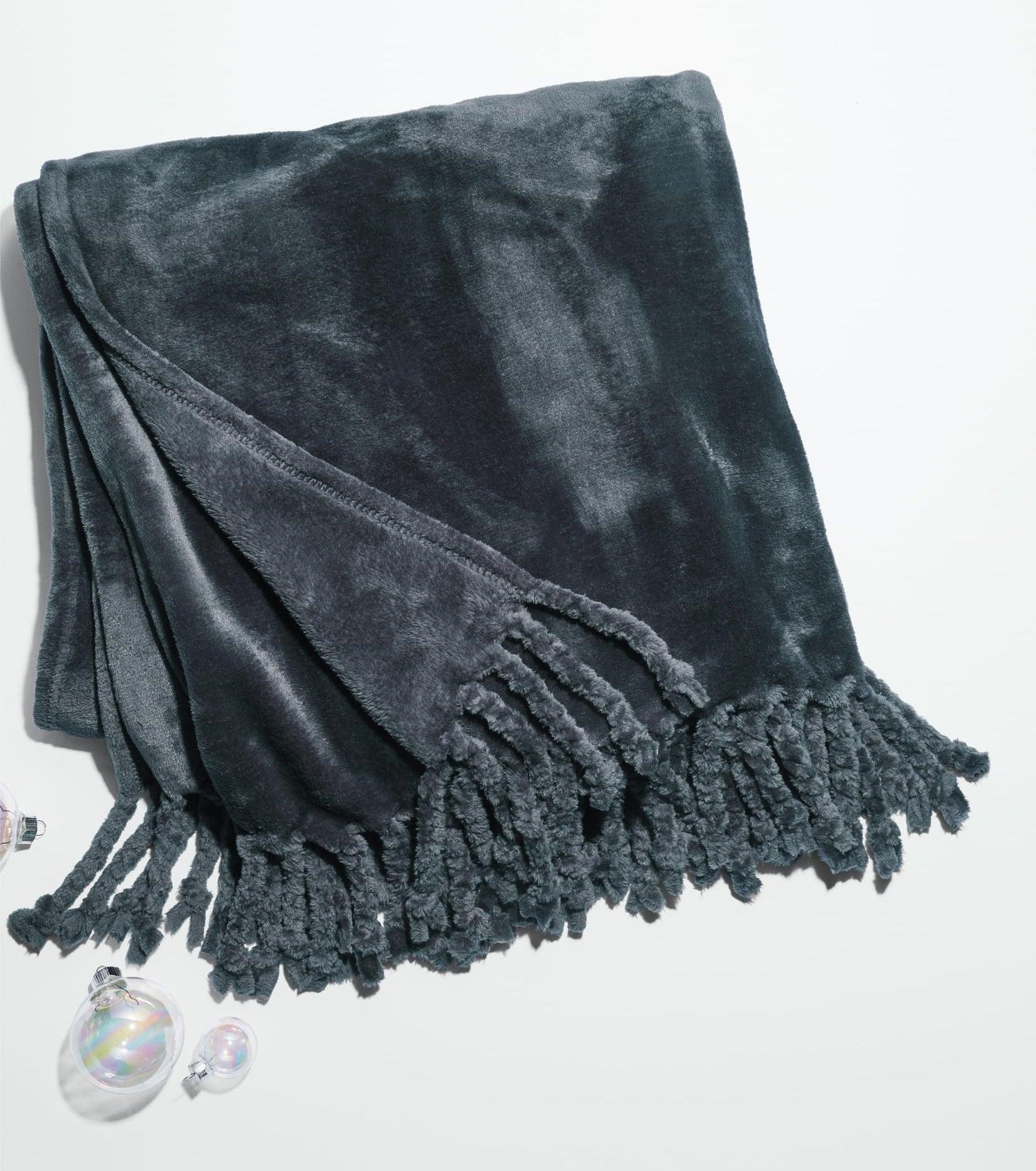 plush looking blanket with tassel trim