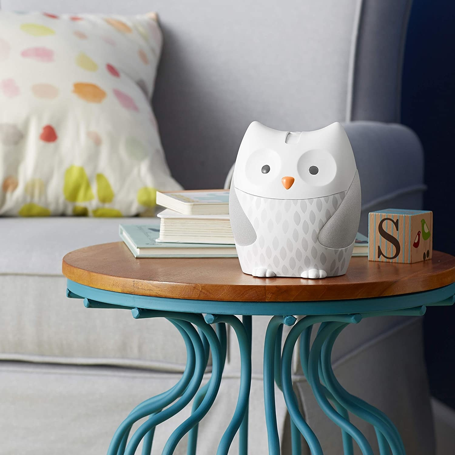 Noise machine shaped like a white owl with gray accents and an orange beak