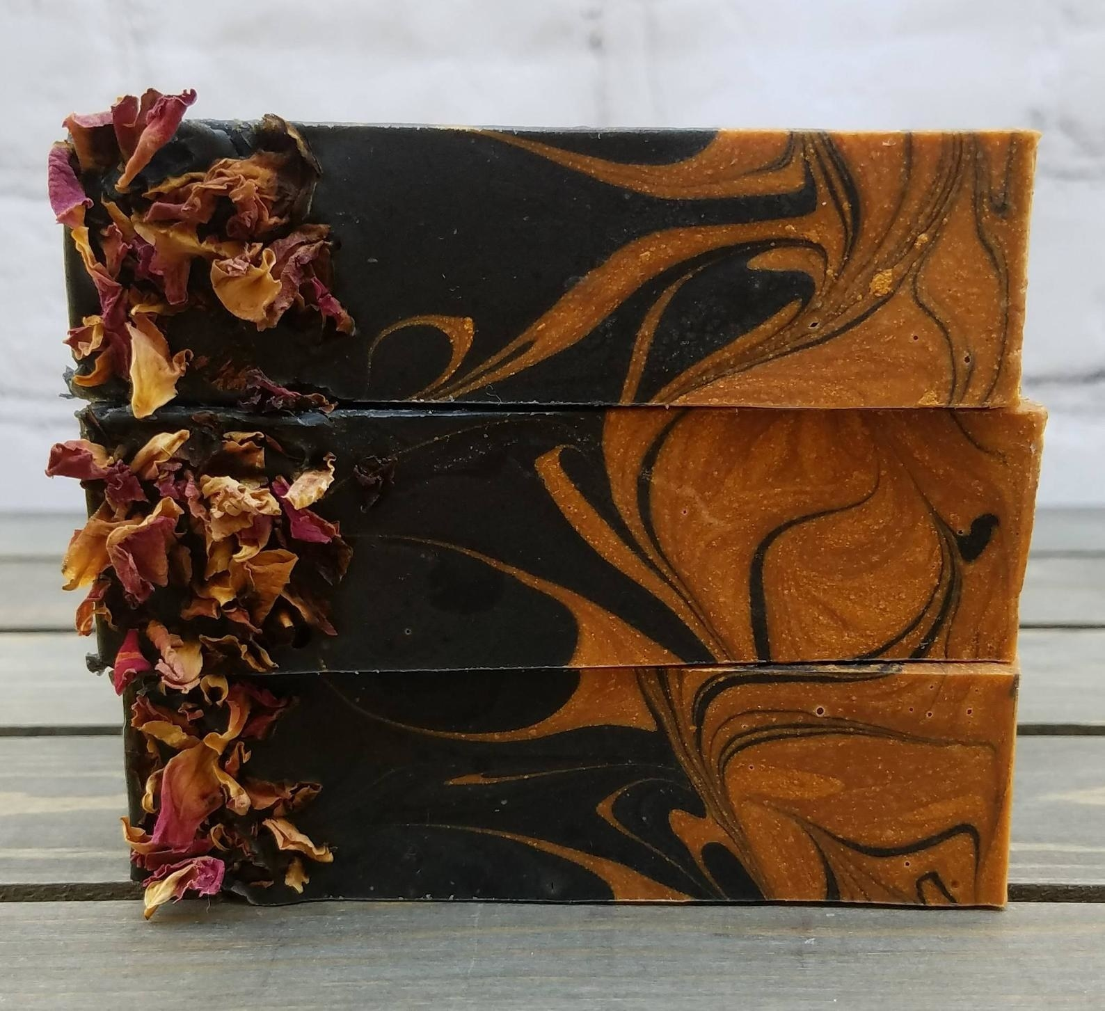 black and gold swirled soap with dry flyers attached to side