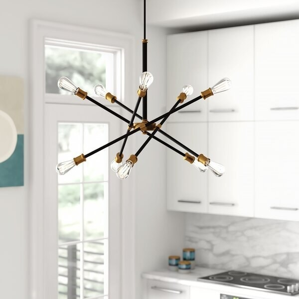 the chandelier hanging in a kitchen