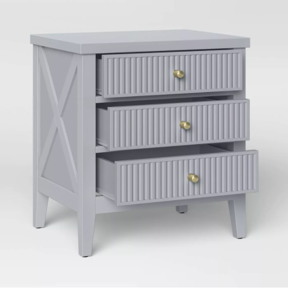 gray nightstand with three drawers and gold tone hardware