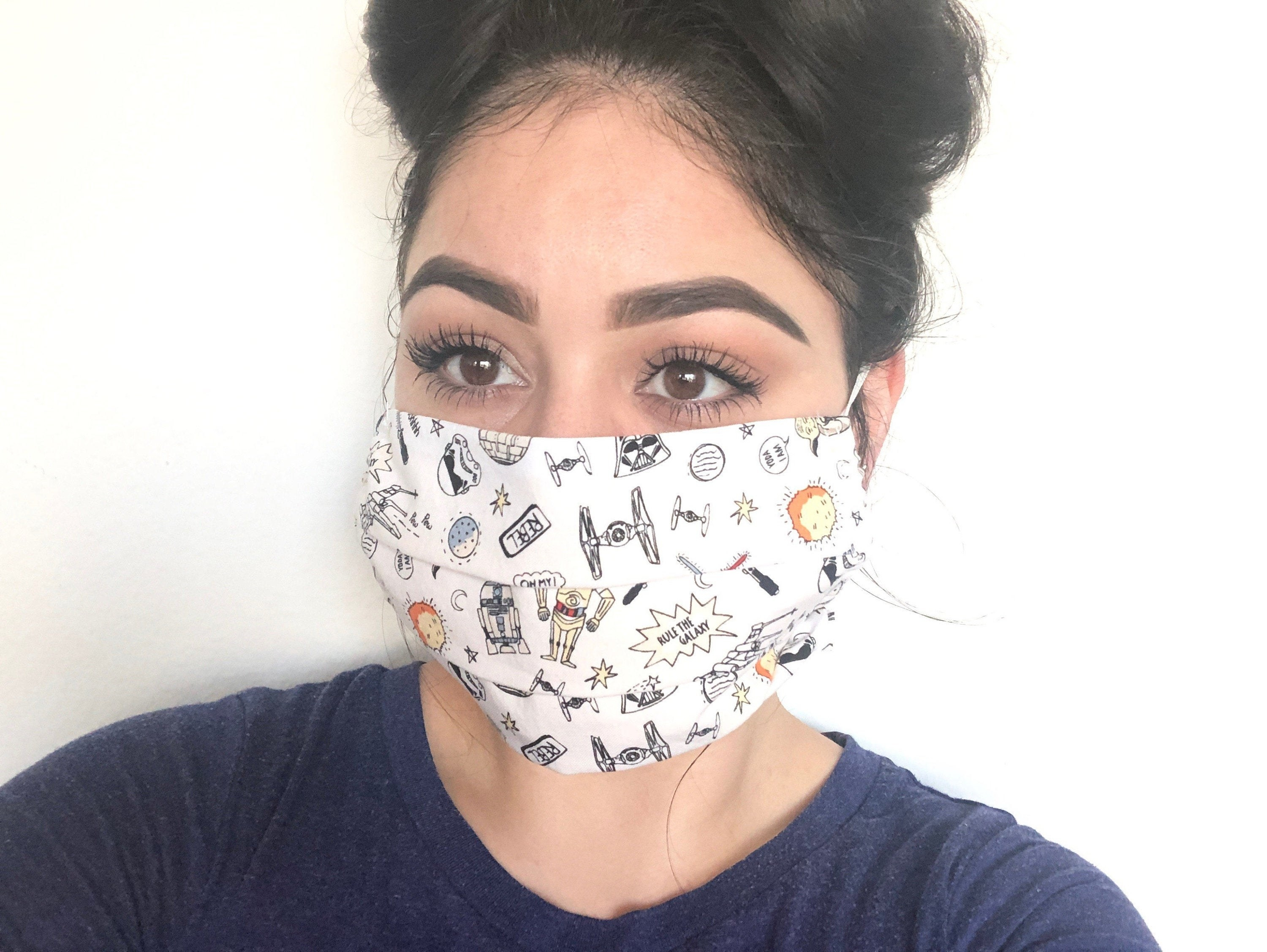 a reviewer in a face mask covered with star wars icons