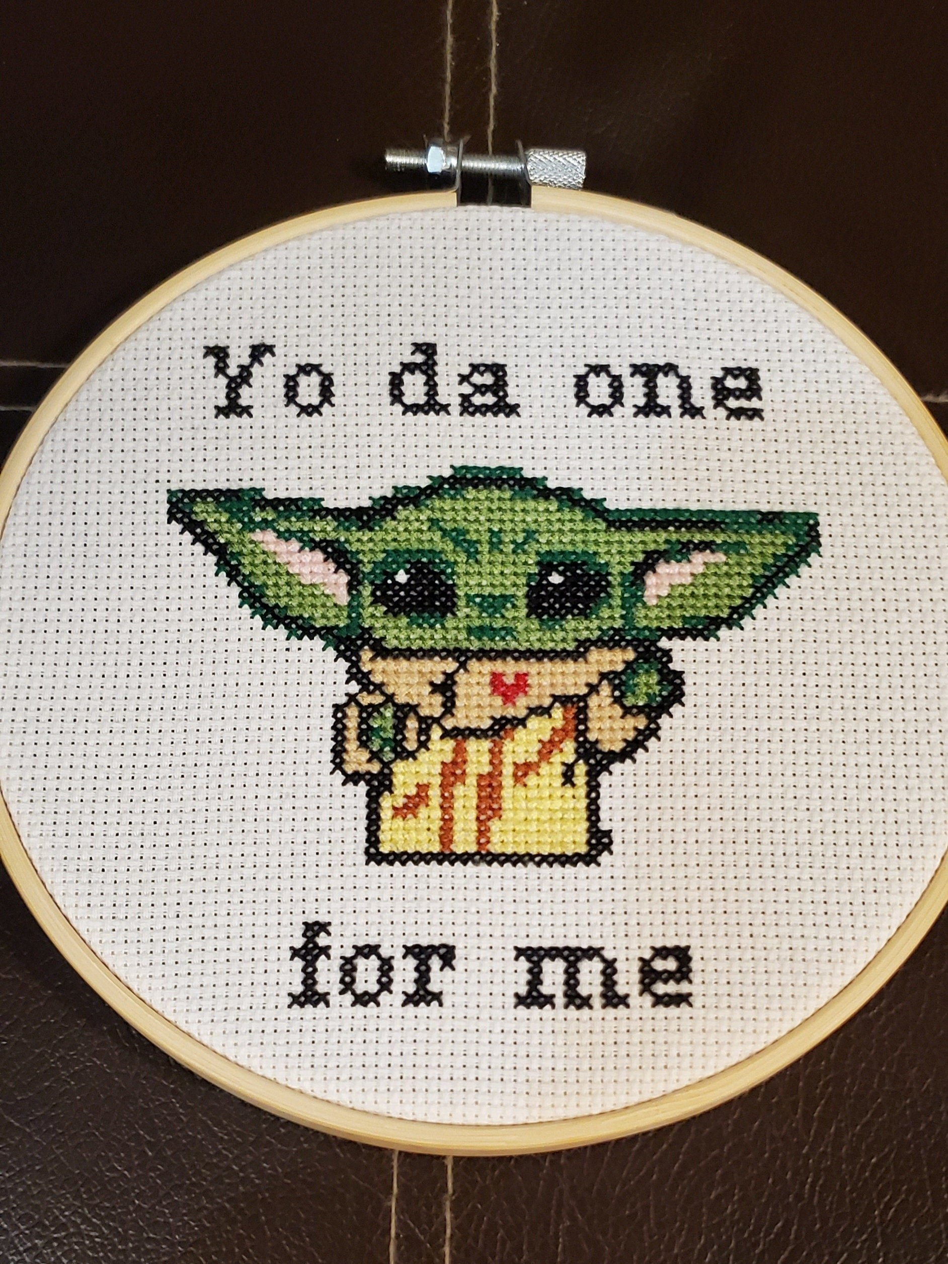 "a cross stitch of baby yoda and ""yo da one for me"""