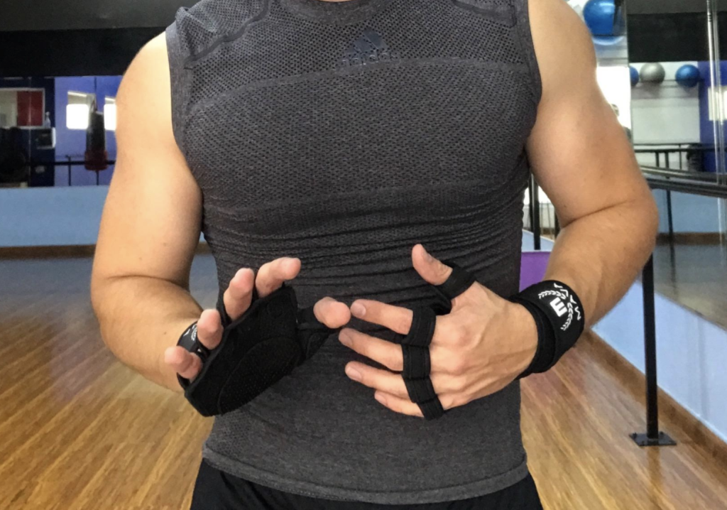a fitness model wearing the gloves