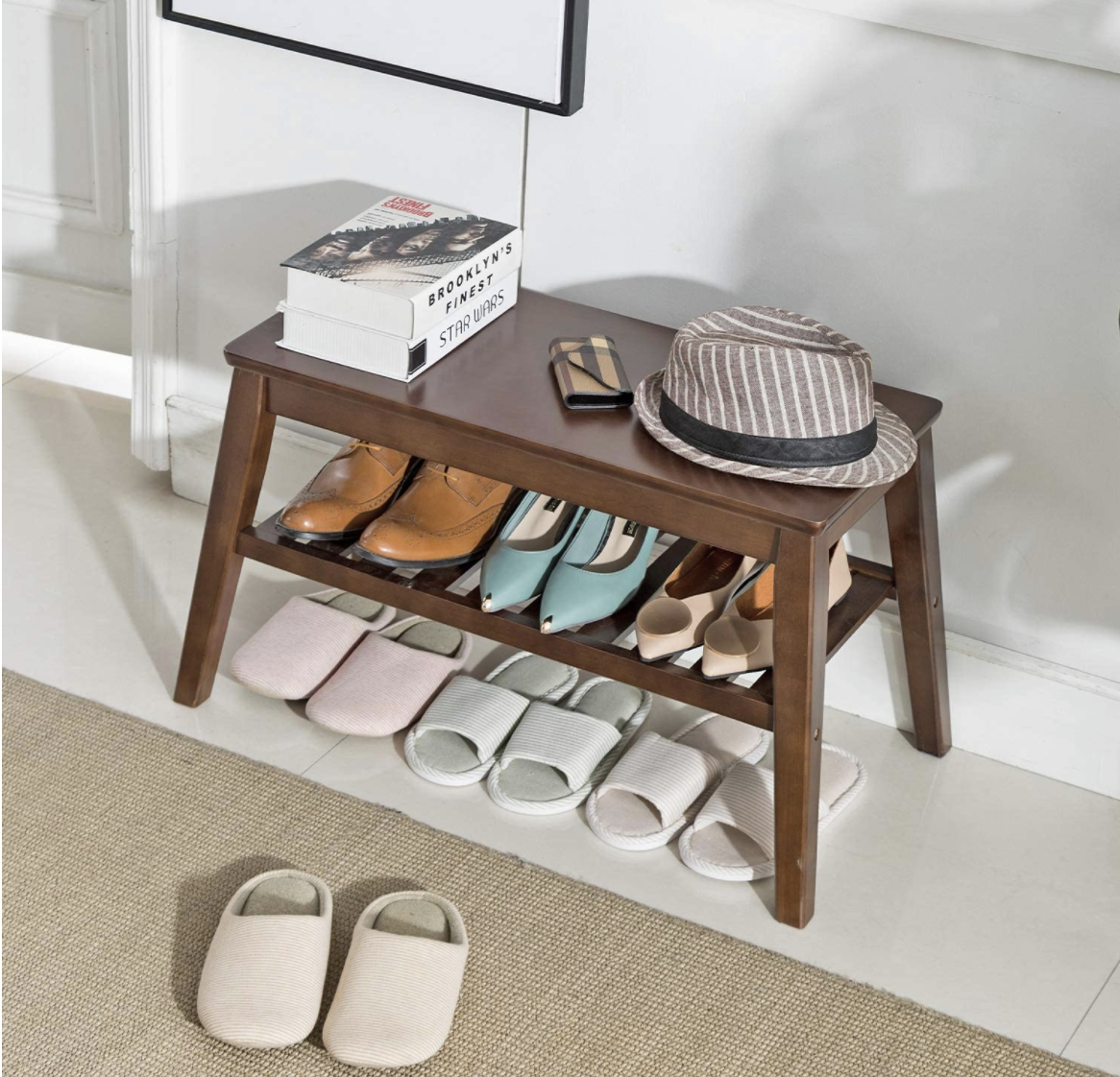 A shoe rack bench storing shoes in a hallway