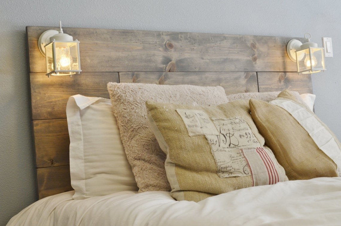 wood headboard with squared off glass frame sconces