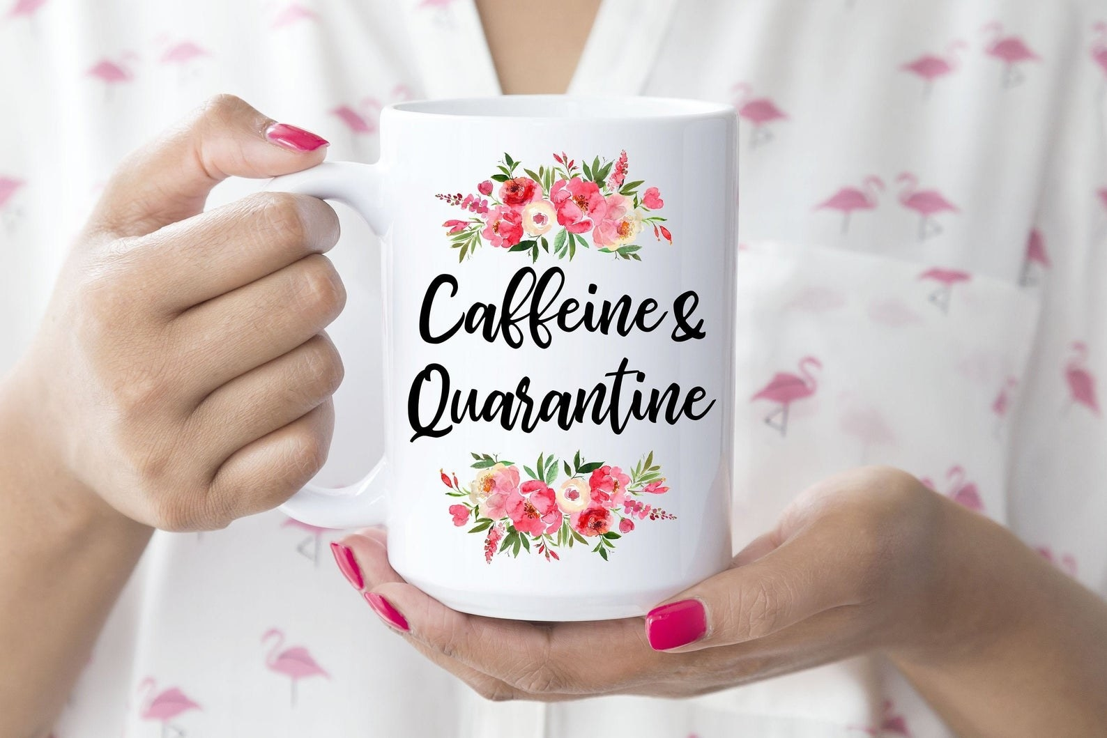 """A mug with floral accents that says """"Caffeine & Quarantine"""""""