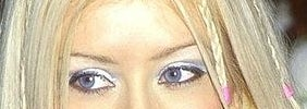 Crop of Christina Aguilera's eye with her wearing frosty blue eyeshadow