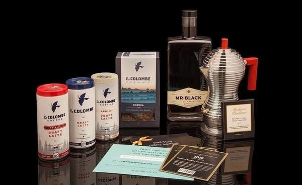 cans of loa colombe lattes, a coffee maker, a bottle of liquor, and more