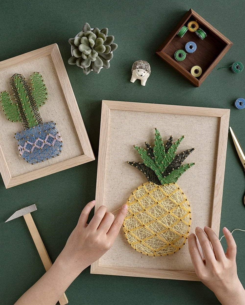 A model working on pineapple string art