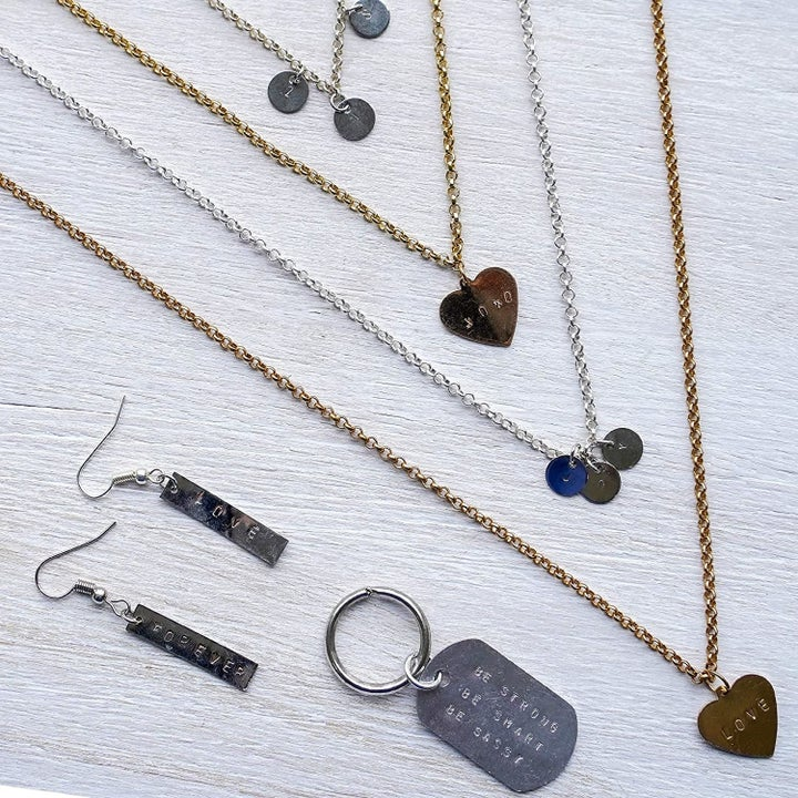Several pieces of jewelry with stamped metal pieces
