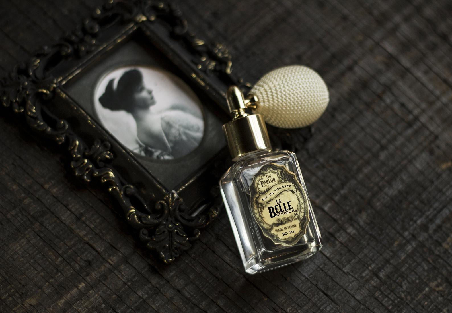 tiny perfume bottle next to an old photo