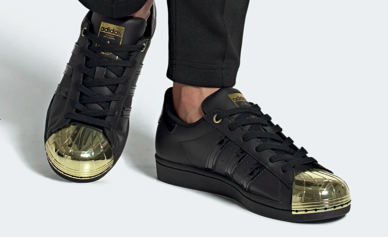 Black shoes with a golden toe cap