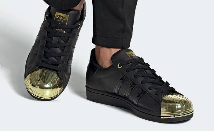 The shoes in black with a gold toe cap