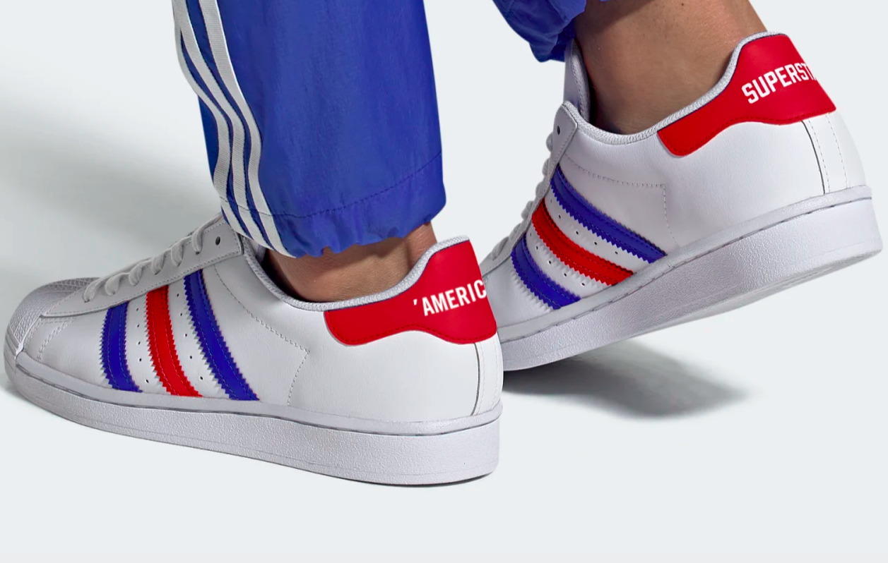 The shoes, which say Americana and Superstar on the back heel