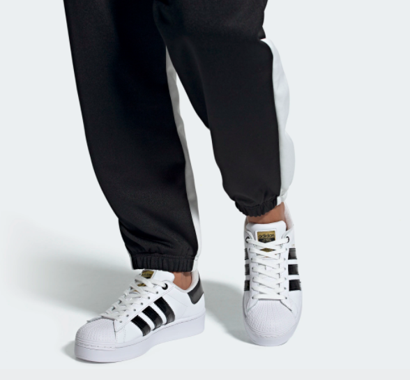 The shoes in white, which have thicker black stripes and a platform sole