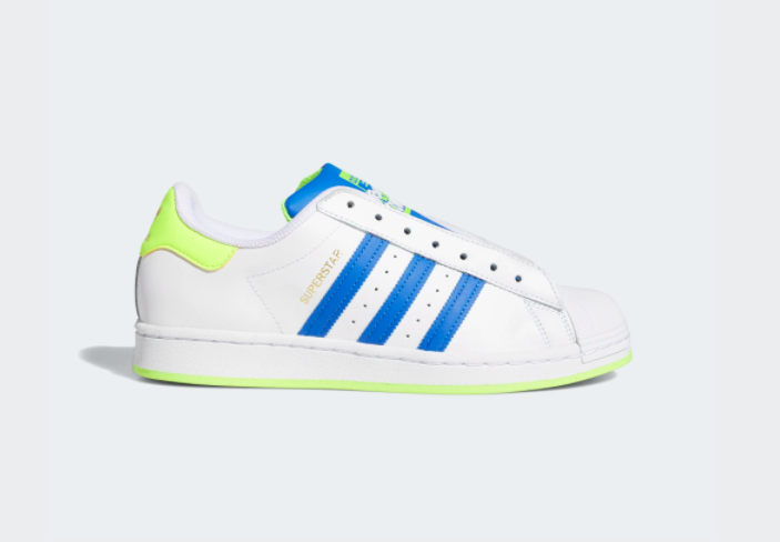 A shoe with a white base and bright blue classic adidas stripes down the side with a vibrant lime green sole and heel