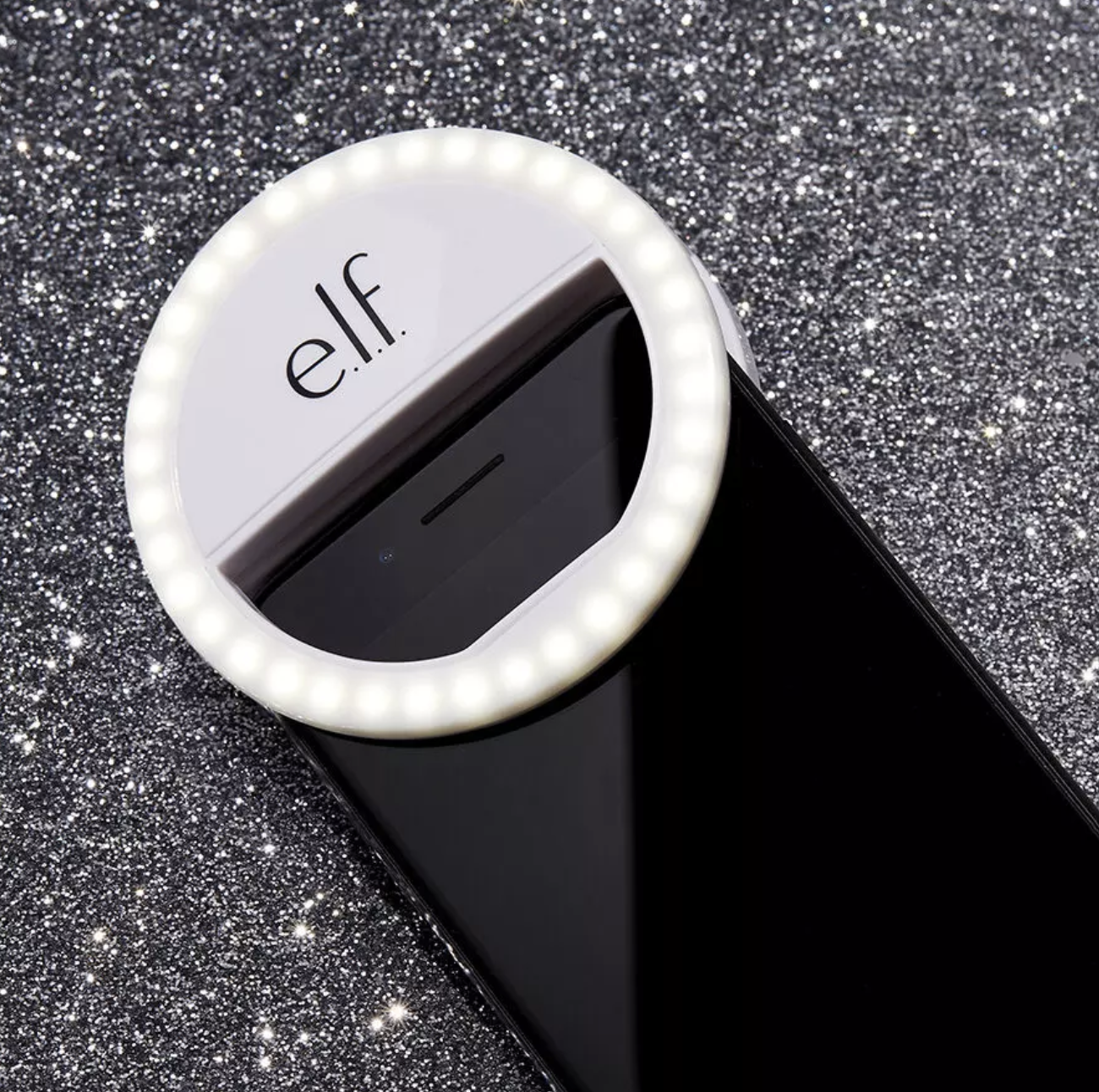 the selfie ring light attached to the top of a phone
