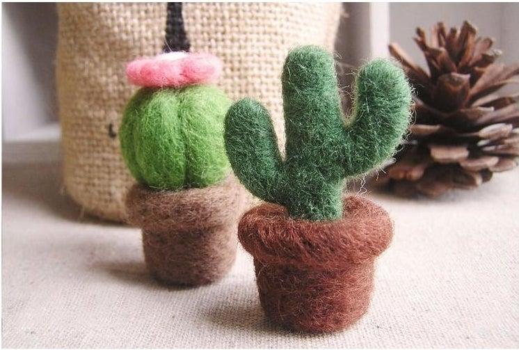 A felt cactus and felt succulent in felt pots