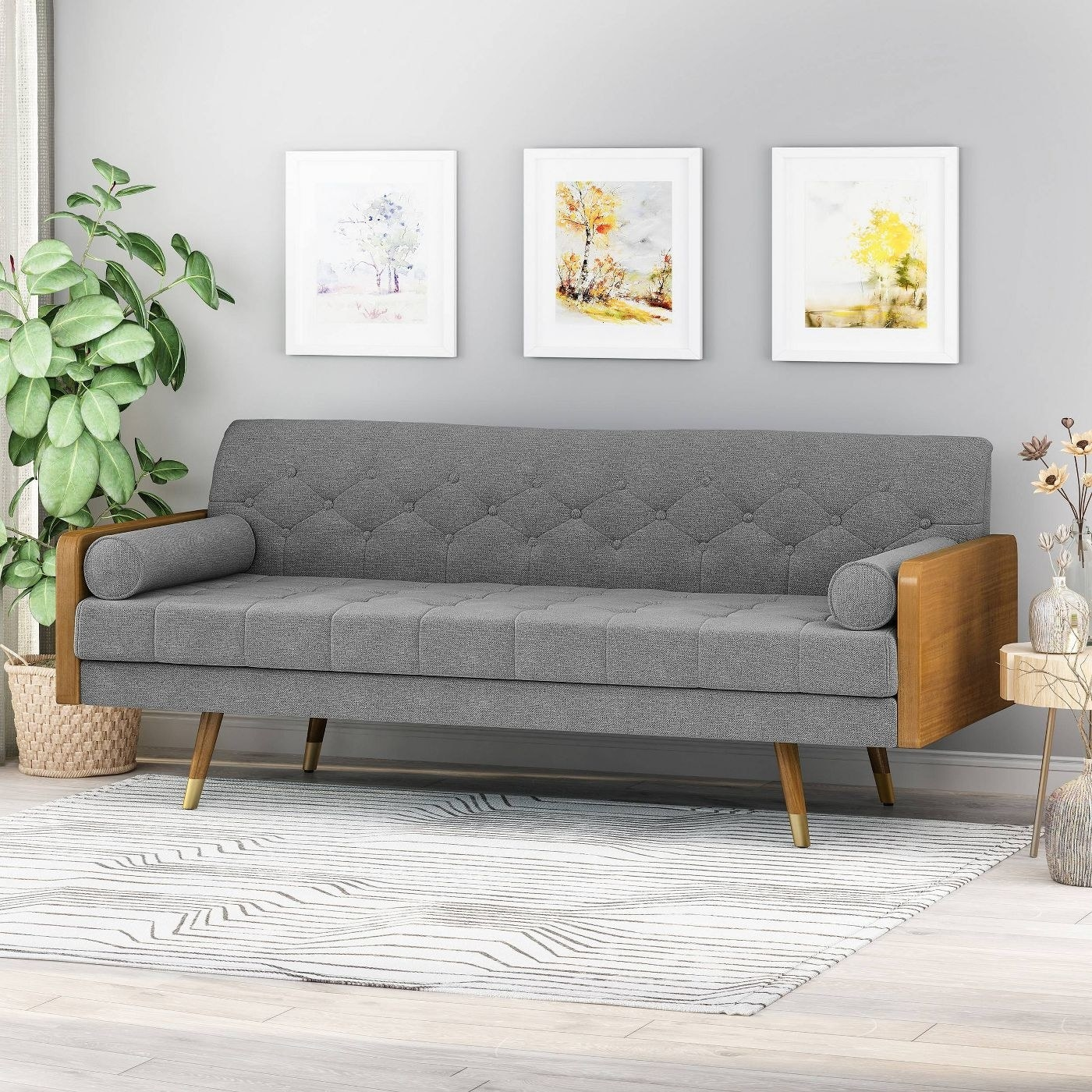 Mid-century modern grey couch with wooden accent legs and arms