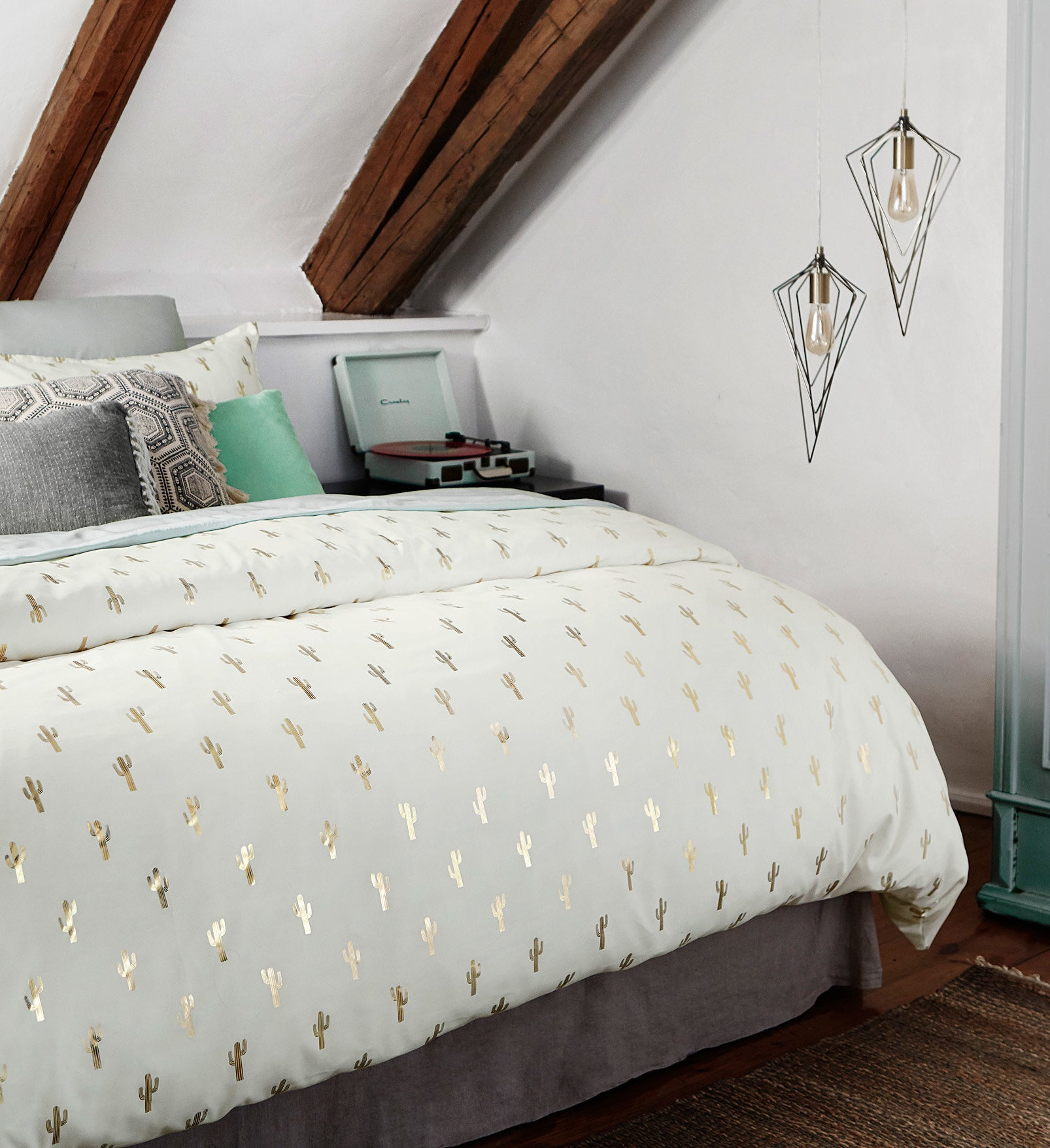 A thick duvet on a large bed with pillows