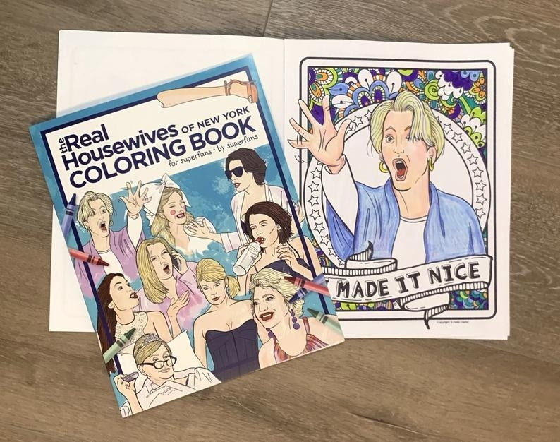 "The front of the coloring book with illustrations of some of the housewives and then an open page below it showing an Illustration of Dorinda Medley with the words ""Made it Nice"" below"