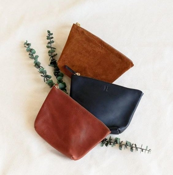 The leather pouches in red, black, and brown
