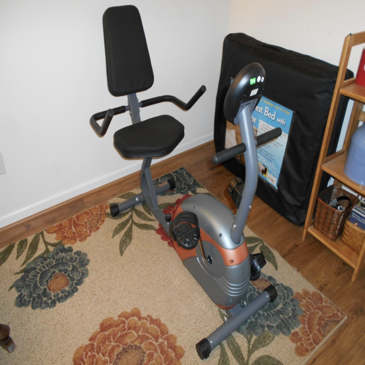black and silver exercise bike in a corner