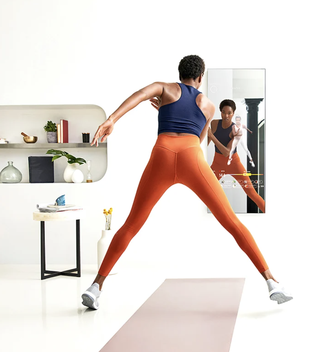 model completes a workout in front of The Mirror