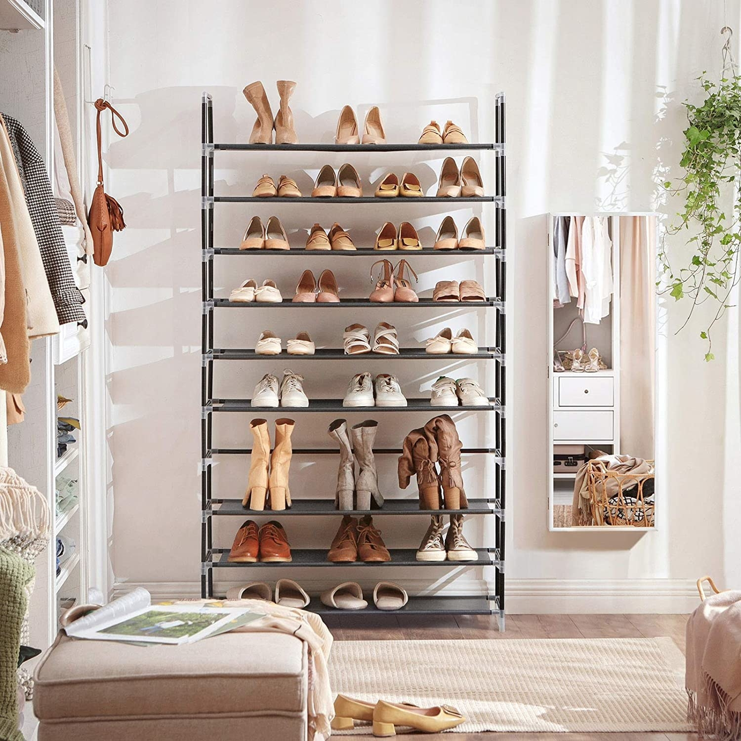 A shoe rack with ten shelves displaying shoes, slip-ons, and boots in a bedroom