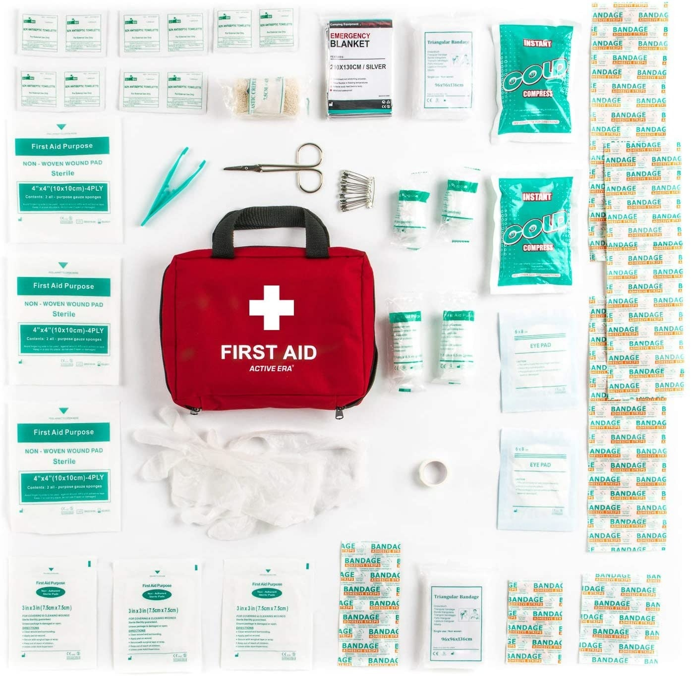 A red first aid bag with its contents neatly arranged around it including bandages and rubber gloves