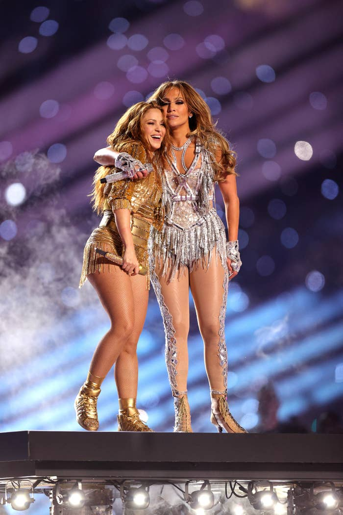 Shakira and J.LO embracing at the end of their performance
