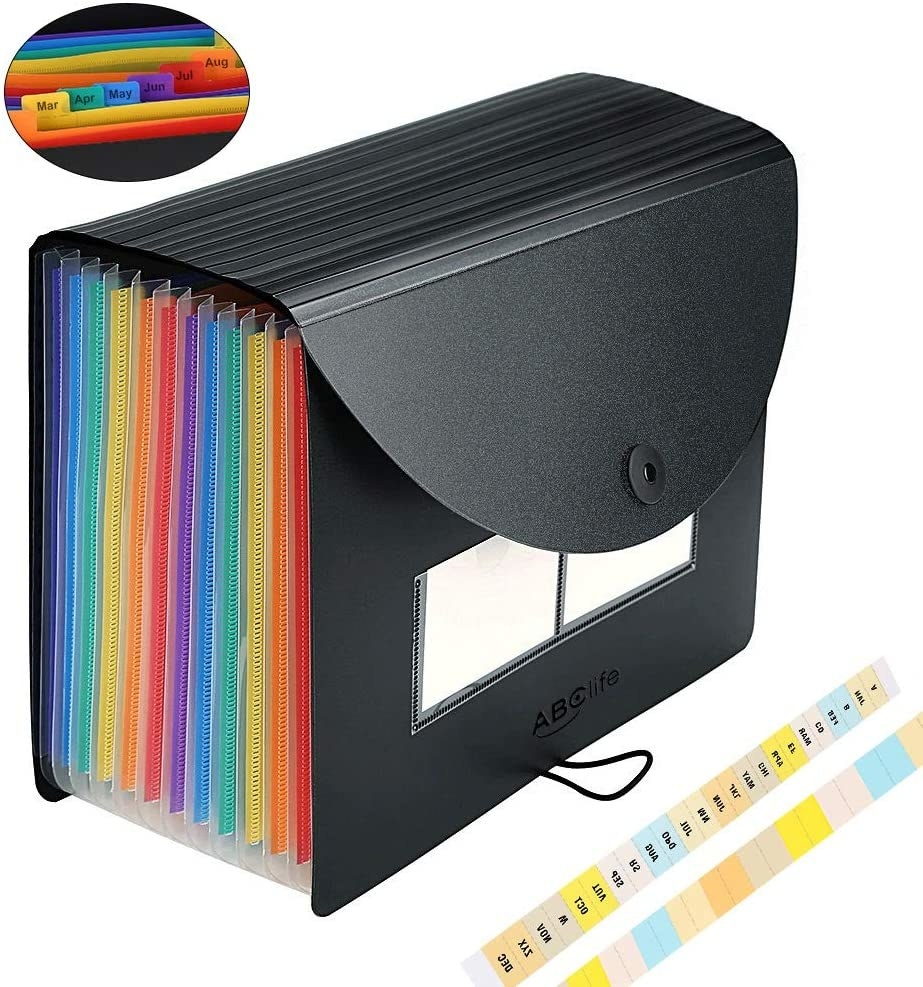 A black plastic expandable organizer with multi-colored file folders and tabs for the months